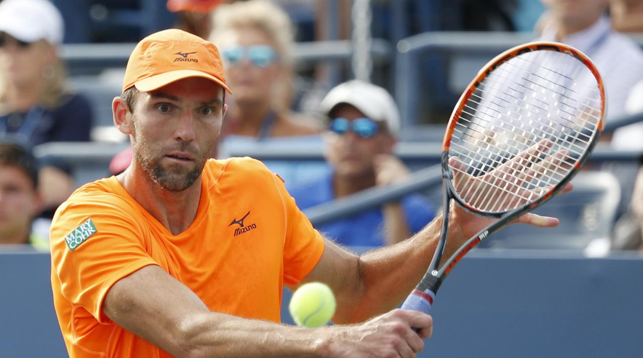 Ivo Karlovic, of Croatia, returns a shot to Kei Nishikori, of Japan, during the fourth round of the U.S. Open tennis tournament, Monday, Sept. 5, 2016, in New York. (AP Photo/Jason DeCrow)