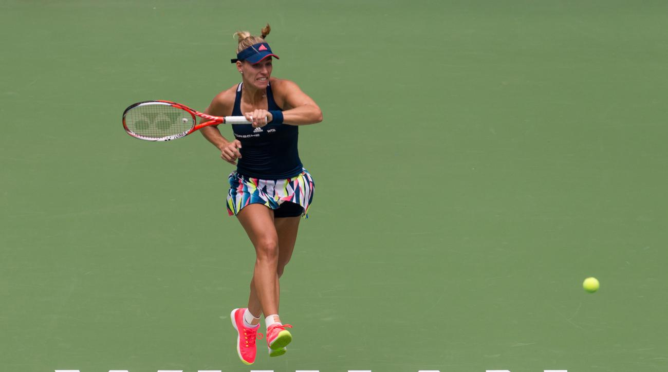 Angelique Kerber of Germany hits a return ball while playing against Kristina Mladenovic of France during the WTA Wuhan Open in Wuhan in central China's Hubei province Tuesday, Sept. 27, 2016. (Chinatopix via AP)