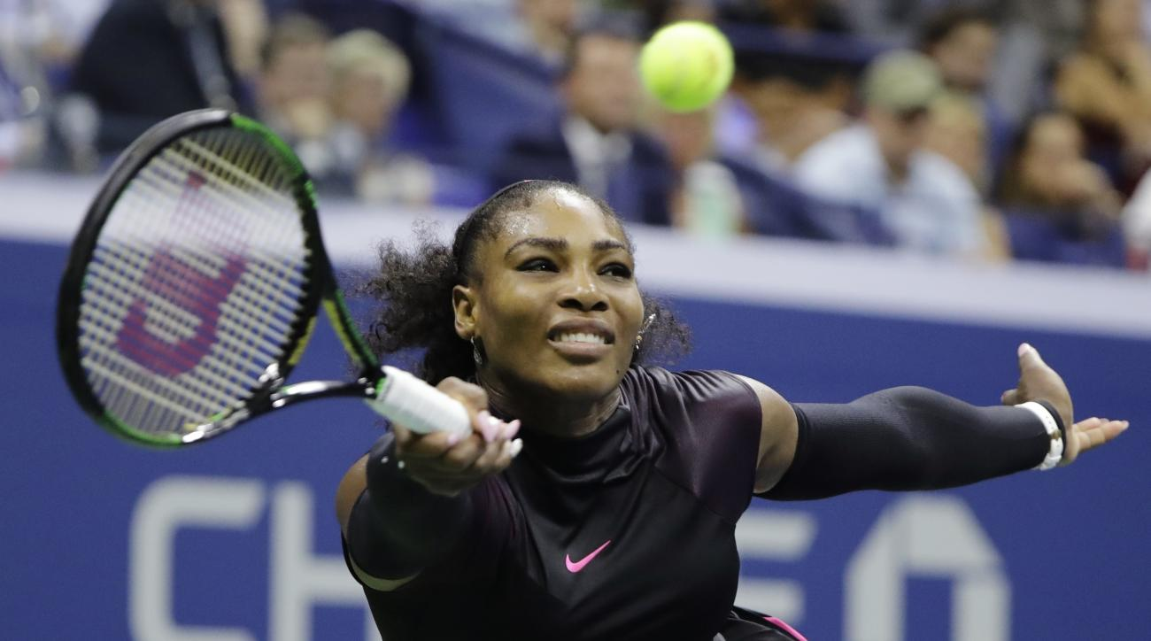 FILE - In this Thursday, Sept. 8, 2016 file photo, Serena Williams returns a shot to Karolina Pliskova, of the Czech Republic, during the semifinals of the U.S. Open tennis tournament, in New York. Williams says she wont be silent about the killing of bla