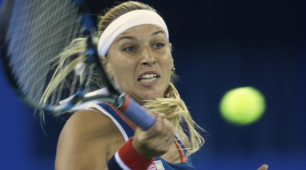 Dominika Cibulkova of Slovakia returns a shot during her women's singles final match against Petra Kvitova of the Czech Republic at the WTA Wuhan Open in Wuhan in central China's Hubei province Saturday, Oct. 1, 2016. (Chinatopix via AP)