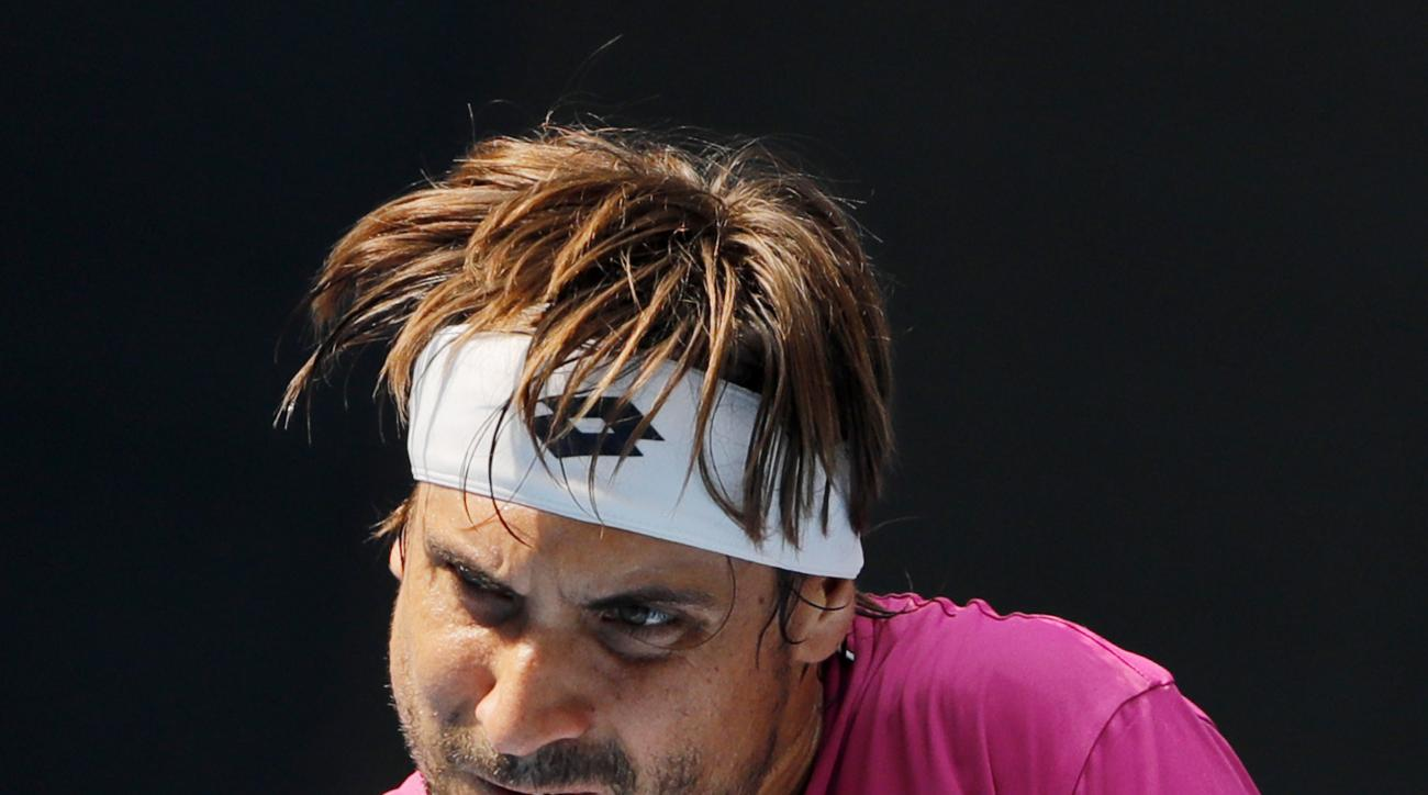 David Ferrer of Spain hits a return shot against Pablo Cuevas of Uruguay during their men's singles match of the China Open tennis tournament at the National Tennis Stadium in Beijing, Monday, Oct. 3, 2016. AP Photo/Andy Wong)