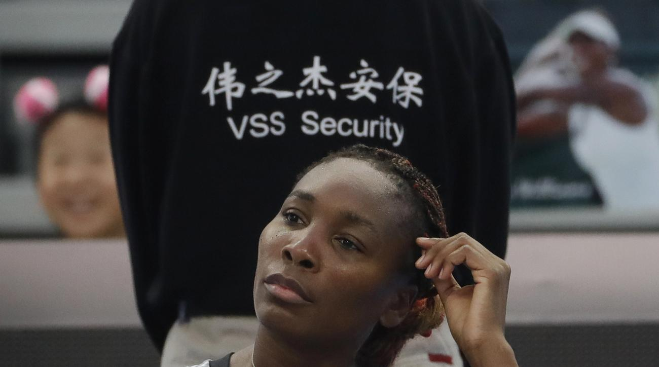 Venus Williams of the United States is seated during a break in her women's singles against Peng Shuai of China at the China Open tennis tournament at the National Tennis Stadium in Beijing, Monday, Oct. 3, 2016. (AP Photo/Andy Wong)