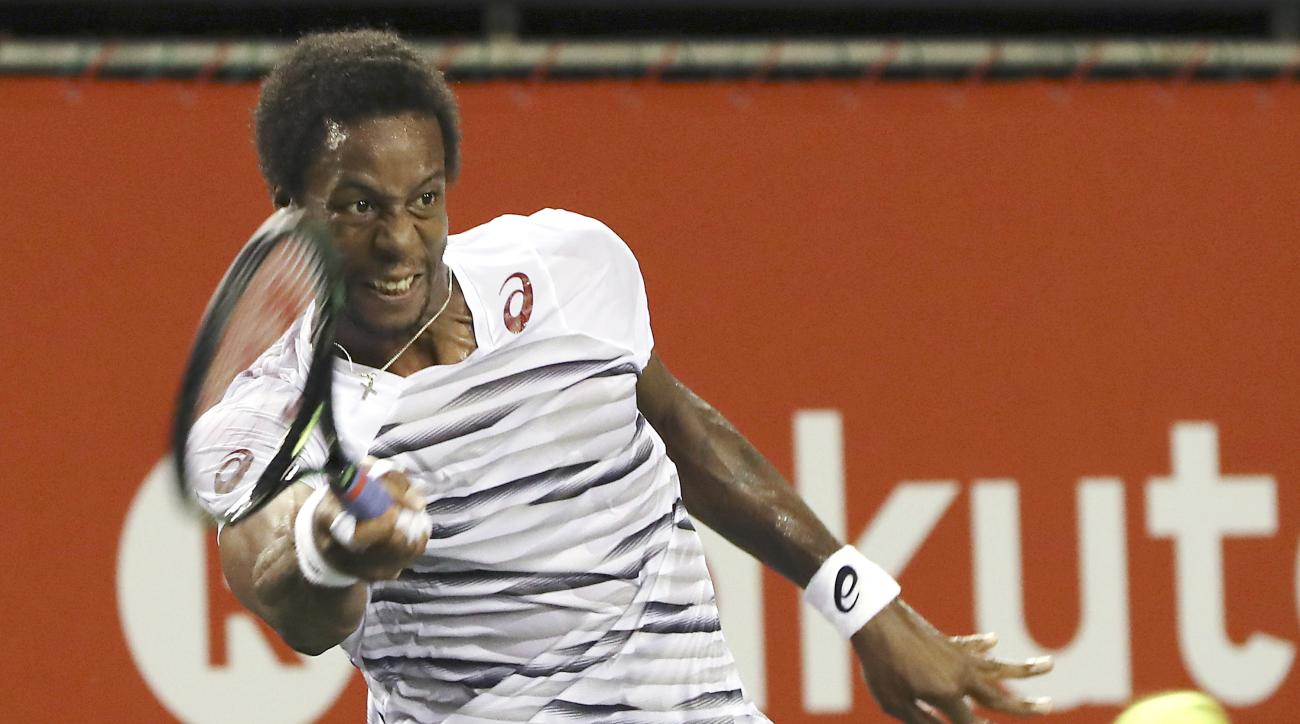 Gael Monfils, of France, returns a shot against Yuichi Sugita, of Japan, during their singles match at the Japan Open mens tennis tournament in Tokyo, Tuesday, Oct. 4, 2016.  (AP Photo/Eugene Hoshiko)