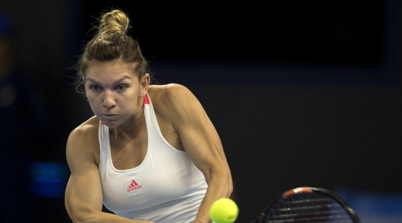 Simona Halep of Romania returns a shot to Zhang Shuai of China during a women's singles match at the China Open tennis tournament in Beijing, Thursday, Oct. 6, 2016. (AP Photo/Ng Han Guan)