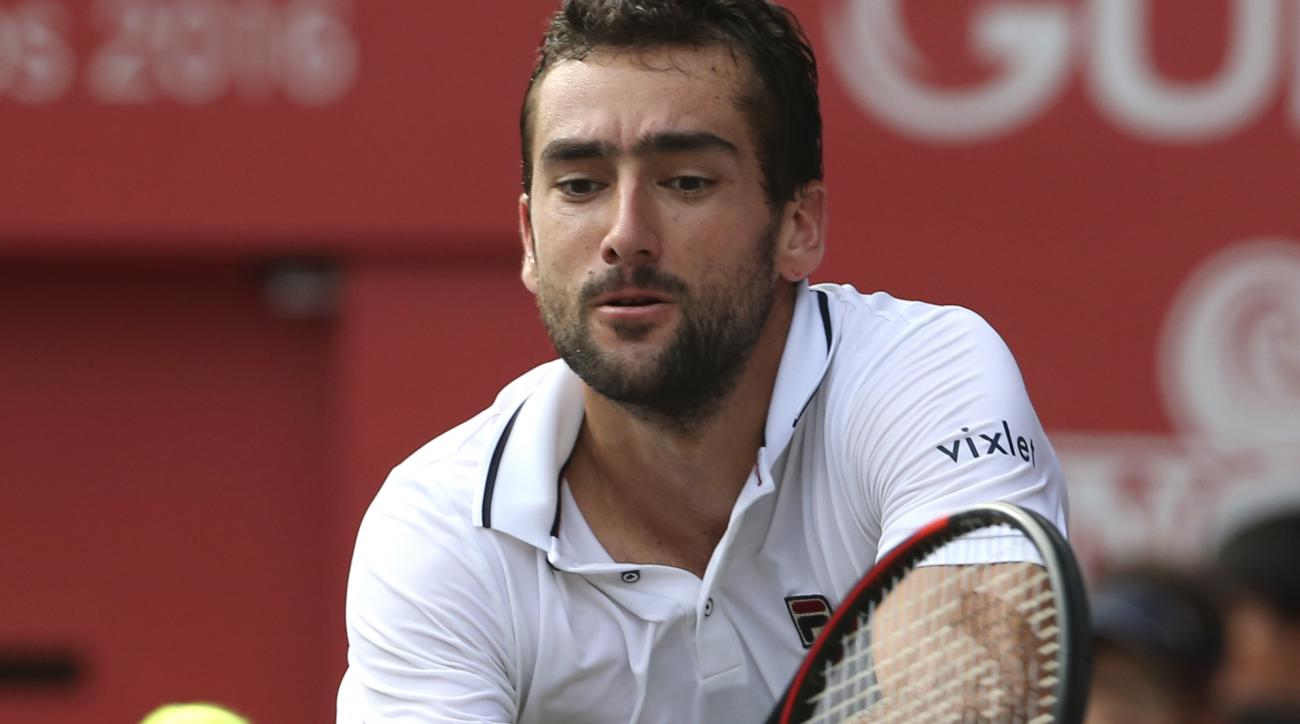 Croatia's Marin Cilic returns a shot against Juan Monaco of Argentina during the quarterfinal  match of Japan Open tennis championships in Tokyo, Friday, Oct. 7, 2016. (AP Photo/Koji Sasahara)