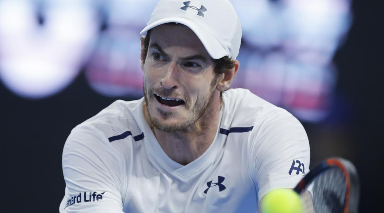 Andy Murray of Britain hits a return shot against his compatriot Kyle Edmund during the men's singles quarterfinals of the China Open tennis tournament at the Diamond Court in Beijing, Friday, Oct. 7, 2016. (AP Photo/Andy Wong)