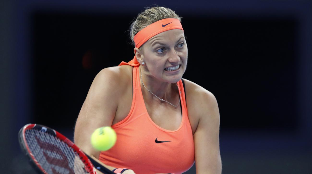 Petra Kvitova of the Czech Republic hits a return shot against Madison Keys of the United States during the women's singles quarterfinals of the China Open tennis tournament at the Diamond Court in Beijing, Friday, Oct. 7, 2016. (AP Photo/Andy Wong)