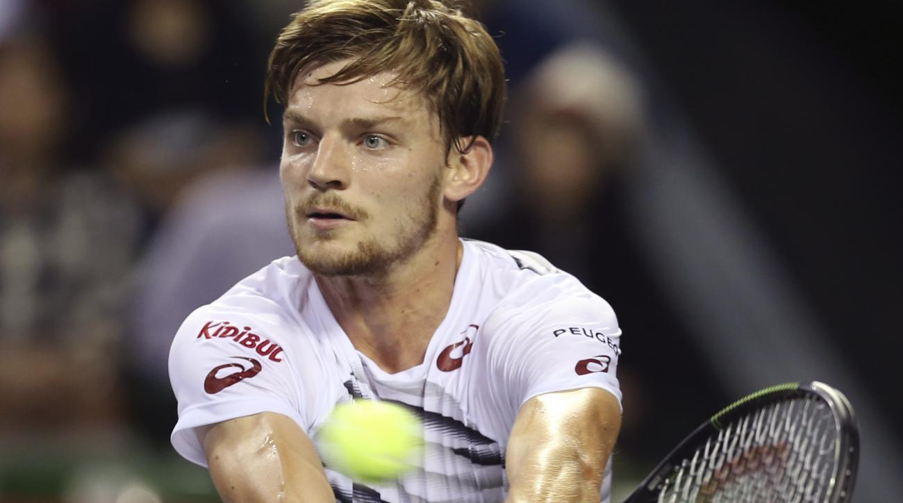 David Goffin of Belgium returns a shot against Croatia's Marin Cilic during the semifinal match of Japan Open tennis championships in Tokyo, Saturday, Oct. 8, 2016. (AP Photo/Koji Sasahara)
