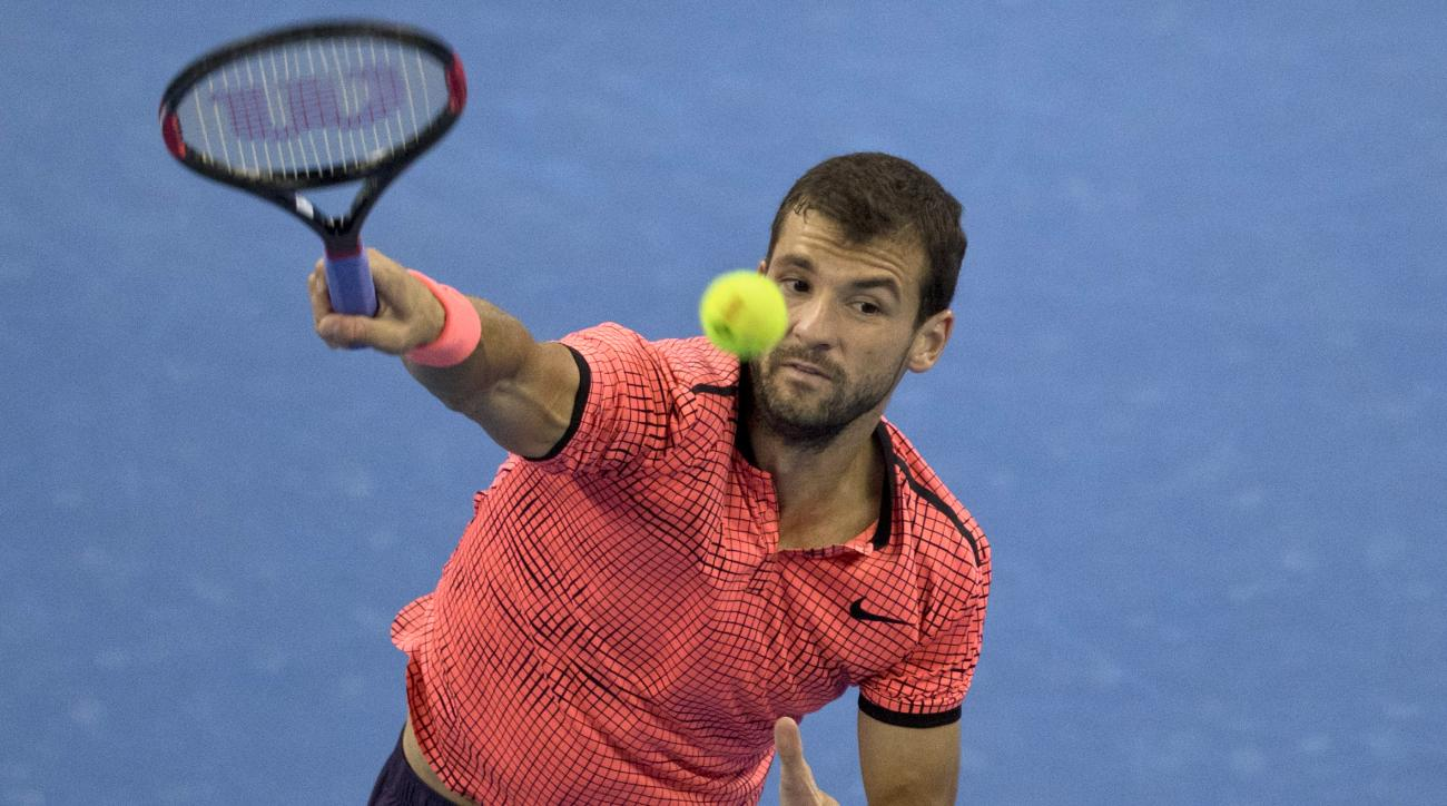 Grigor Dimitrov of Bulgaria returns a shot from Andy Murray of Britain in the men's singles final match at the China Open tennis tournament in Beijing, Sunday, Oct. 9, 2016. (AP Photo/Ng Han Guan)
