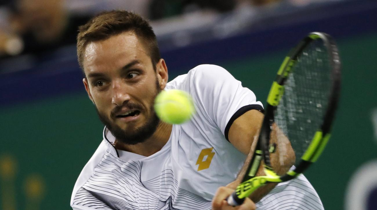 Viktor Troicki of Serbia hits a return shot against Rafael Nadal of Spain during the men's singles match of the Shanghai Masters tennis tournament at Qizhong Forest Sports City Tennis Center in Shanghai, China, Wednesday, Oct. 12, 2016. (AP Photo/Andy Won