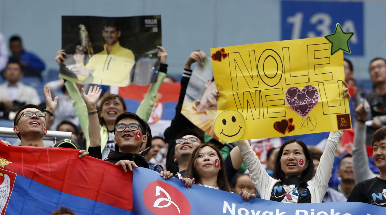 Fans cheer for Novak Djokovic of Serbia during the men's singles match against Vasek Pospisil of Canada in the Shanghai Masters tennis tournament at Qizhong Forest Sports City Tennis Center in Shanghai, China, Thursday, Oct. 13, 2016. (AP Photo/Andy Wong)