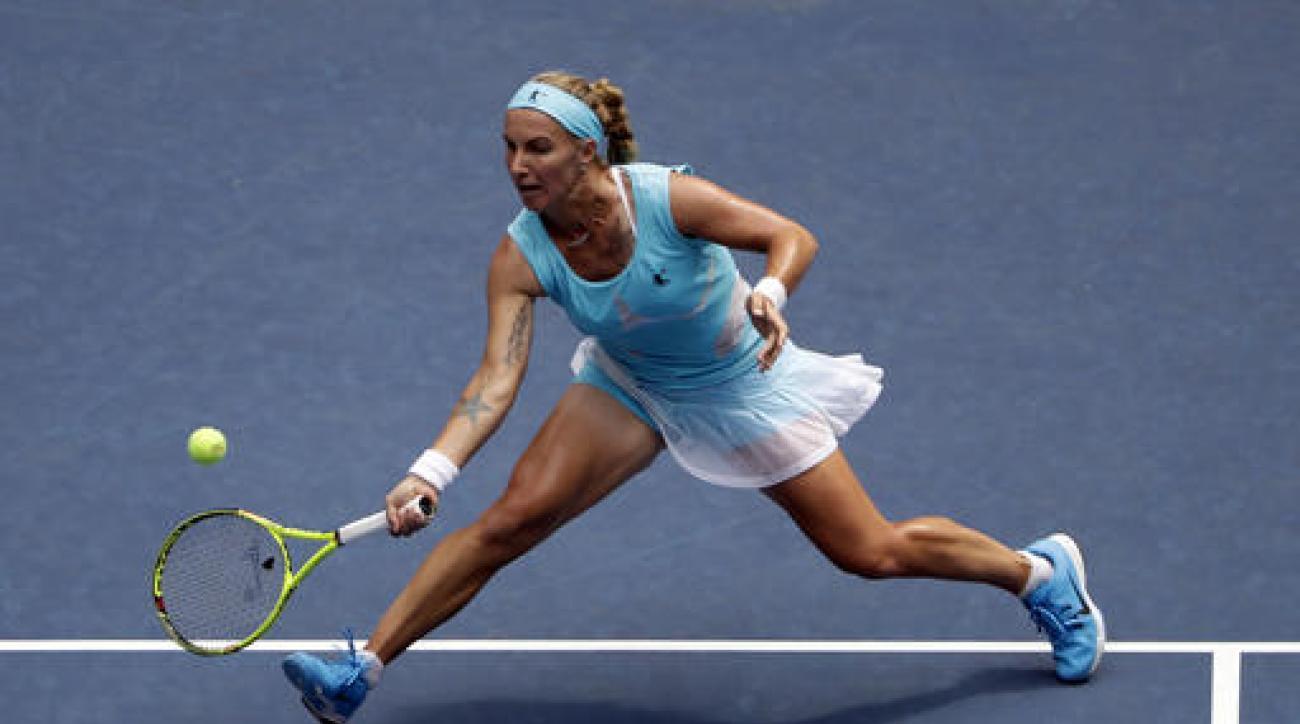 Svetlana Kuznetsova, of Russia, returns a shot to Caroline Wozniacki, of Denmark, during the second round of the U.S. Open tennis tournament, Wednesday, Aug. 31, 2016, in New York. (AP Photo/Seth Wenig)
