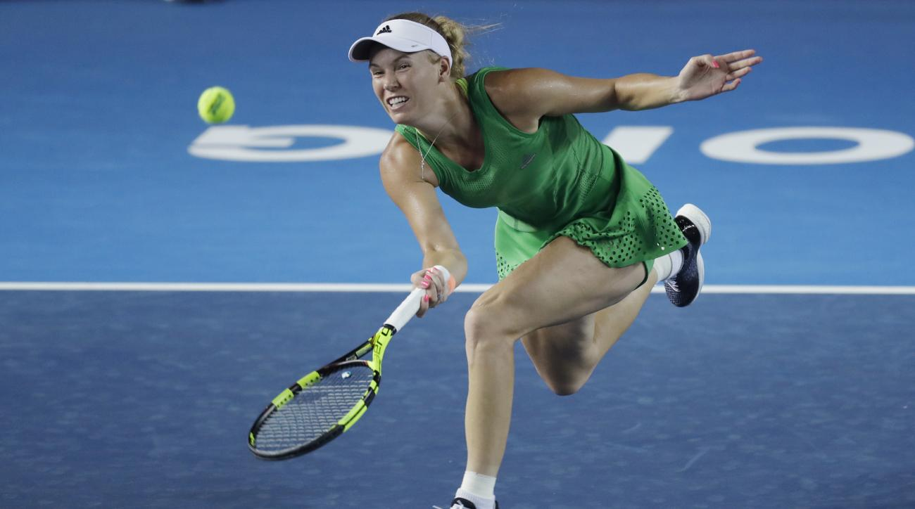 Caroline Wozniacki of Denmark returns a shot to Jelena Jankovic of Serbia during the semi-final match at the Hong Kong Open tennis tournament in Hong Kong, Saturday, Oct. 15, 2016. (AP Photo/Kin Cheung)