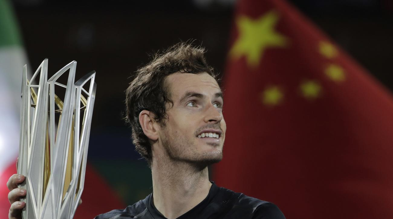 Andy Murray of Britain holds up his winner trophy after defeating Roberto Bautista Agut of Spain in the men's singles final of the Shanghai Masters tennis tournament at Qizhong Forest Sports City Tennis Center in Shanghai, China, Sunday, Oct. 16, 2016. (A