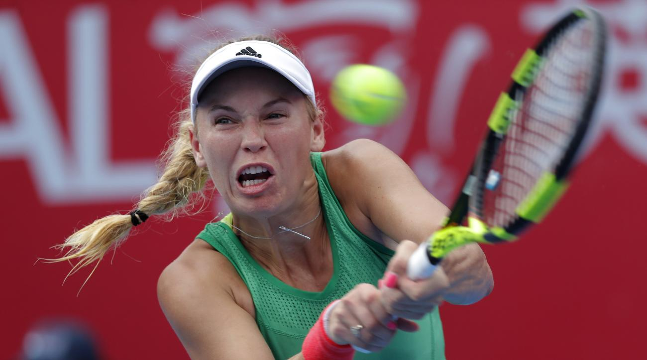 Caroline Wozniacki of Denmark returns the ball to Kristina Mladenovic of France in their final match at the Hong Kong Open tennis tournament in Hong Kong, Sunday, Oct. 16, 2016. Wozniacki won 6-1, 6-7 (4), 6-2. (AP Photo/Vincent Yu)