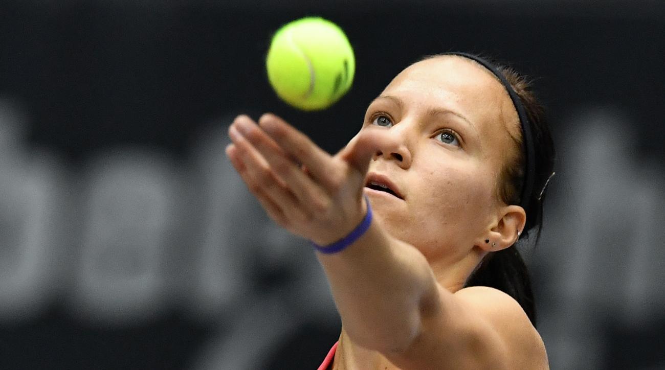 Switzerlands Viktorija Golubic  serves a ball  to Dominika Cibulkova of Slovakia during their final match at the Generali Ladies tennis tournament in Linz, Austria, Sunday, Oct. 16, 2016.(AP Photo/Kerstin Joensson)
