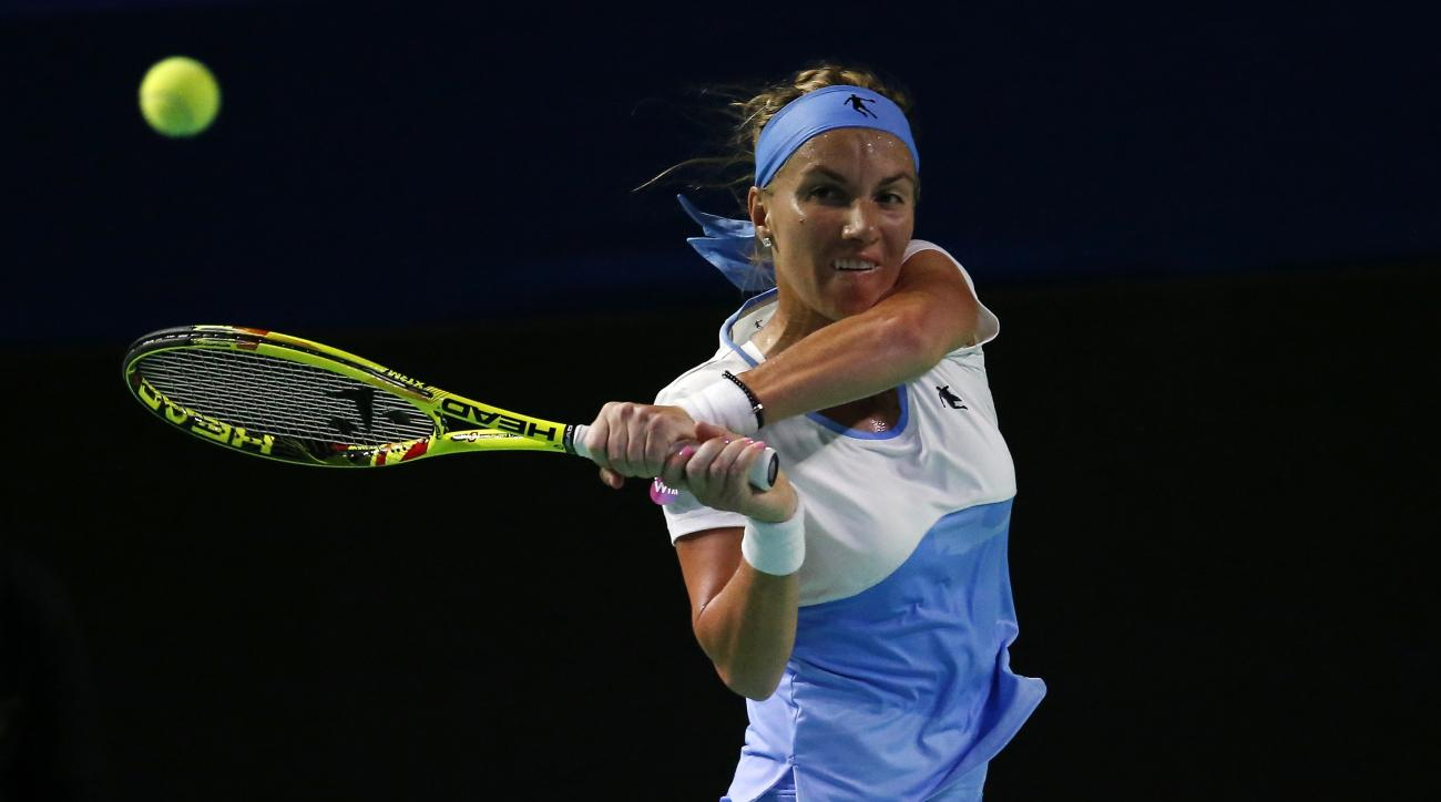 Russia's Svetlana Kuznetsova plays a return during the final match against Australia's Daria Gavrilova at the Kremlin Cup tennis tournament in Moscow, Russia, Saturday, Oct. 22, 2016. (AP Photo/Alexander Zemlianichenko)
