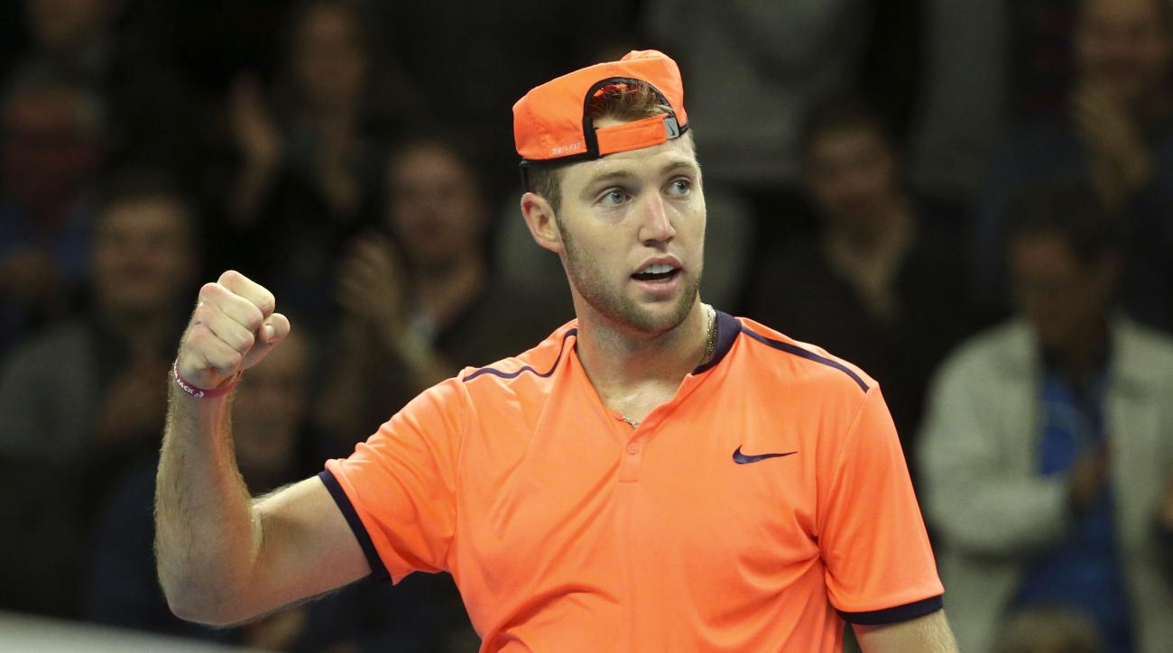 Jack Sock of the U.S celebrates defeating Germany's Alexander Zverev in the men's single semifinal match at the ATP Stockholm Open tennis tournament in Stockholm on Saturday Oct. 22, 2016. (Soren Andersson/TT via AP)