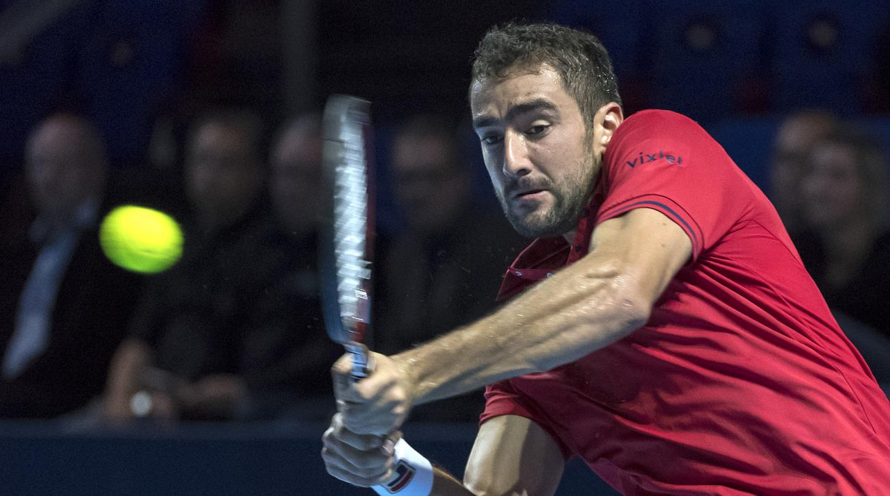 Croatia's Marin Cilic returns a ball to Russia's Mikhail Youzhny in action during their first round match at the Swiss Indoors tennis tournament at the St. Jakobshalle in Basel, Switzerland, on Monday, Oct. 24, 2016. (Georgios Kefalas/Keystone via AP)