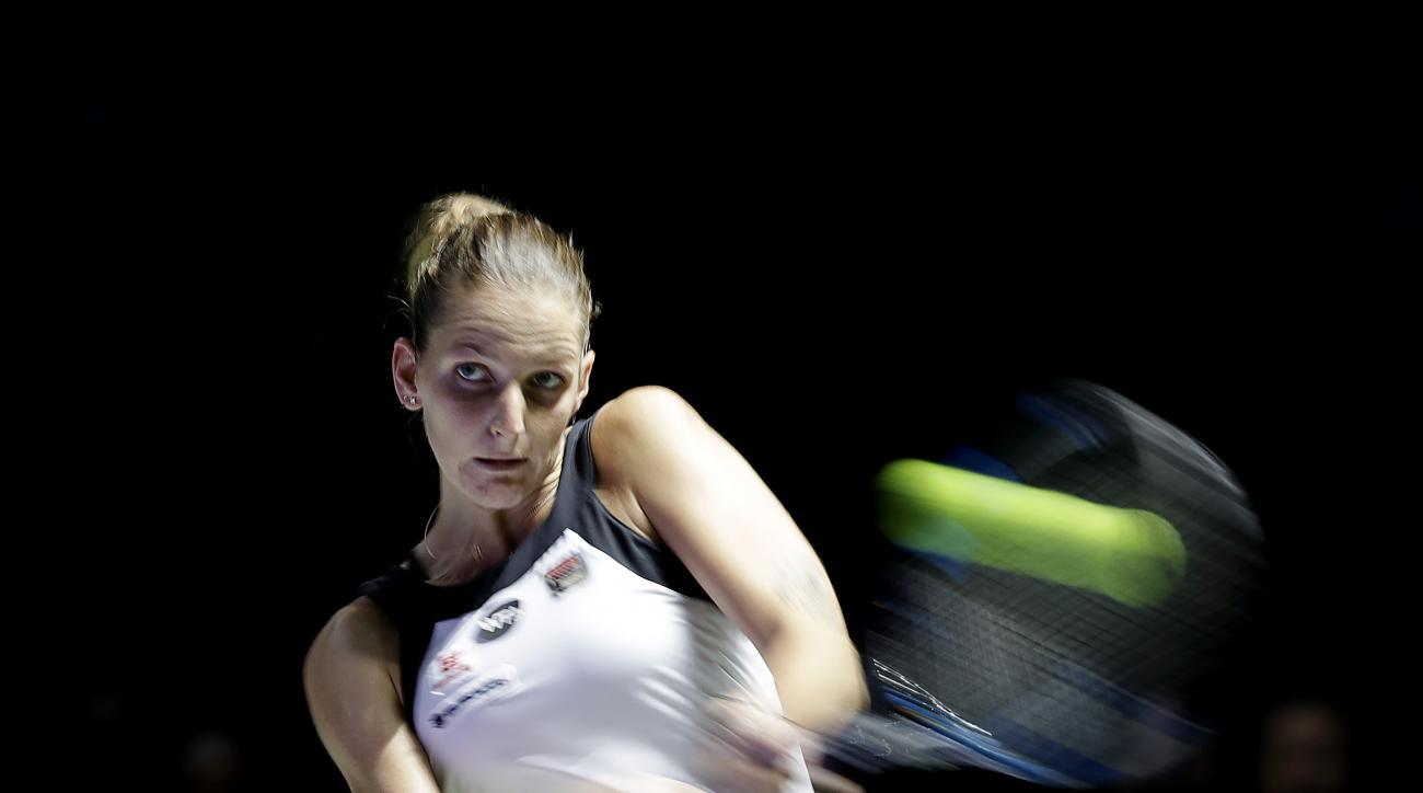 Karolina Pliskova of the Czech Republic makes a backhand return against Svetlana Kuznetsova of Russia during their singles match at the WTA tennis tournament in Singapore, Wednesday, Oct. 26, 2016. (AP Photo/Wong Maye-E)
