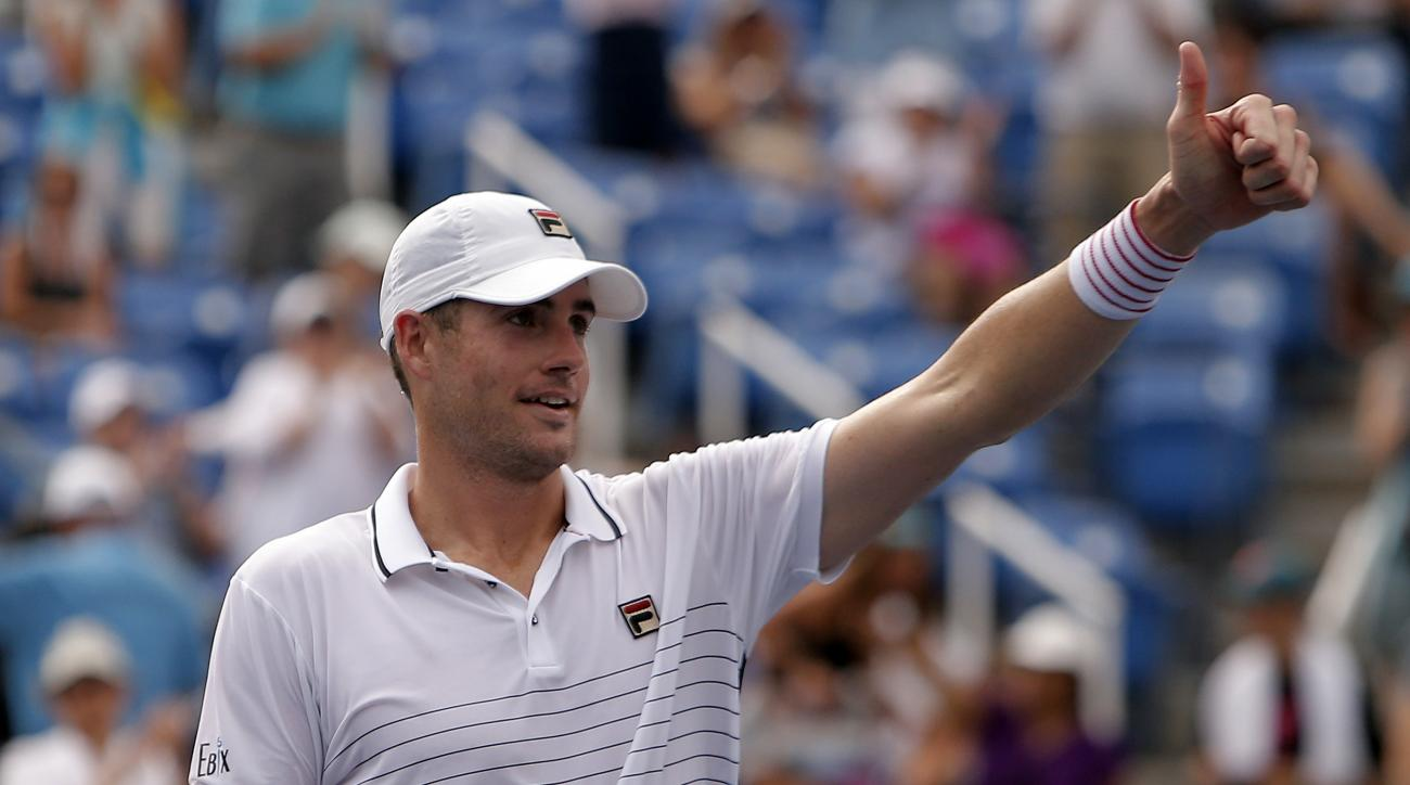 John Isner, of the United States, reacts after beating Steve Darcis, of Belgium, during the second round of the U.S. Open tennis tournament, Wednesday, Aug. 31, 2016, in New York. (AP Photo/Andres Kudacki)