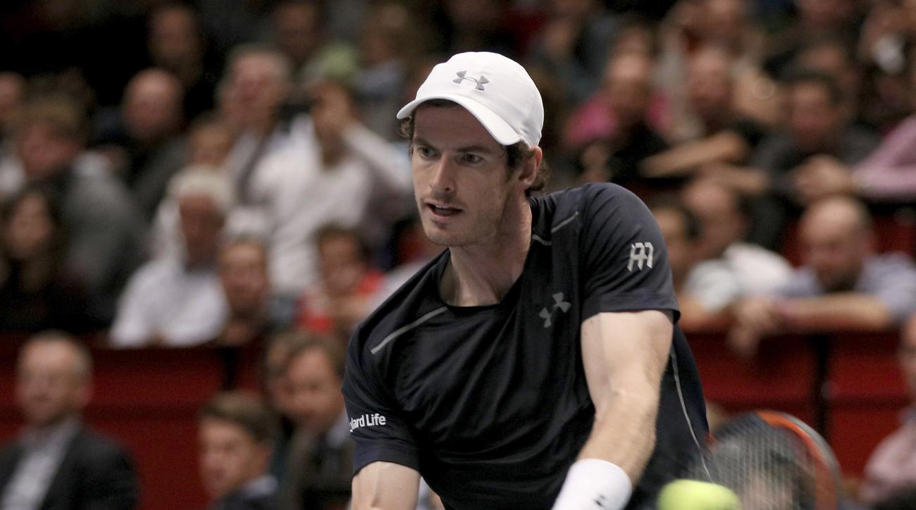 Andy Murray of Great Britain returns a ball to John Isner of the United States during their quarter final match at the Erste Bank Open tennis tournament in Vienna, Austria, Friday, Oct. 28, 2016. (AP Photo/Ronald Zak)