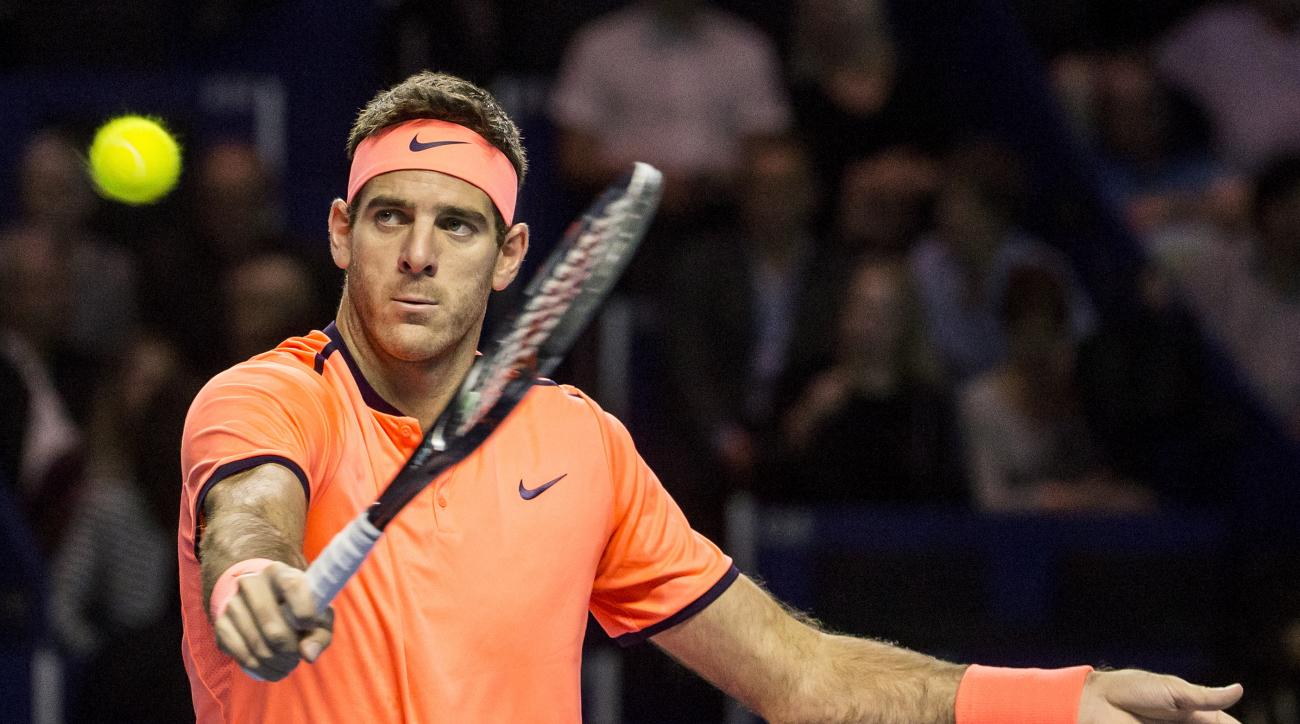 Argentina's Juan Martin Del Potro in action against Japan's Kei Nishikori during their quarterfinal tennis match at the Swiss Indoors tennis tournament in Basel, Switzerland, on Friday, Oct. 28, 2016. (Alexandra Wey/Keystone via AP)