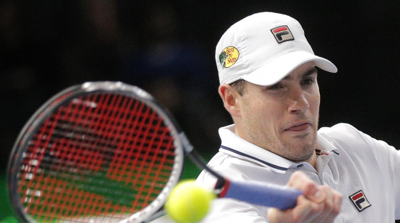 John Isner of the United States returns the ball to Jack Sock of the United States in the quarterfinal match of the Paris Masters tennis tournament at the Bercy Arena in Paris, Friday, Nov. 4, 2016. (AP Photo/Michel Euler)