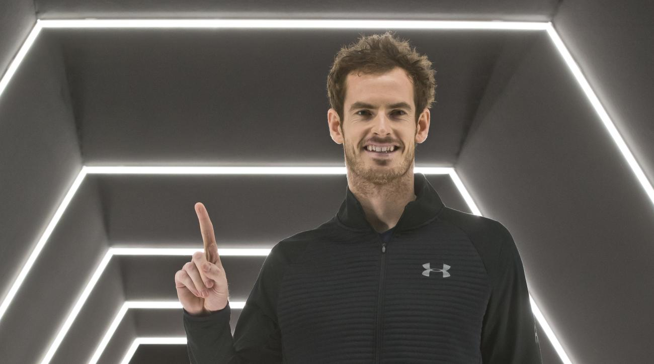 Britain's Andy Murray holds up his finger to show he is No. 1 after winning the final of the Paris Masters tennis tournament against John Isner of the United States in three sets at the Bercy Arena in Paris, Sunday, Nov. 6, 2016. (AP Photo/Michel Euler)