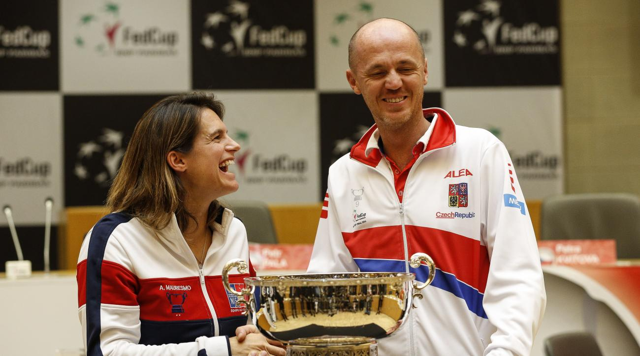 Czech Republic's team captain Petr Pala, right, shares a laugh with French captain Amelie Mauresmo during the Fed Cup final draw in Strasbourg, eastern France, Friday, Nov. 11, 2016. (AP Photo/Jean-Francois Badias)