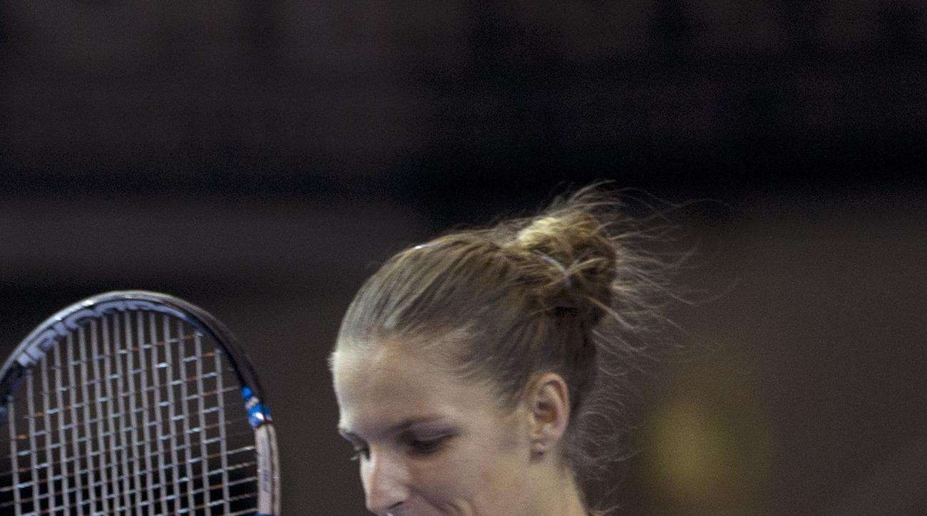 Czech Republic's Karolina Pliskova sticks her tongue out as she defeats France's Kristina Mladenovic during the Fed Cup final in Strasbourg, eastern France, Saturday, Nov. 12, 2016. Czech Republic leads 1-0. (AP Photo/Jean-Francois Badias)