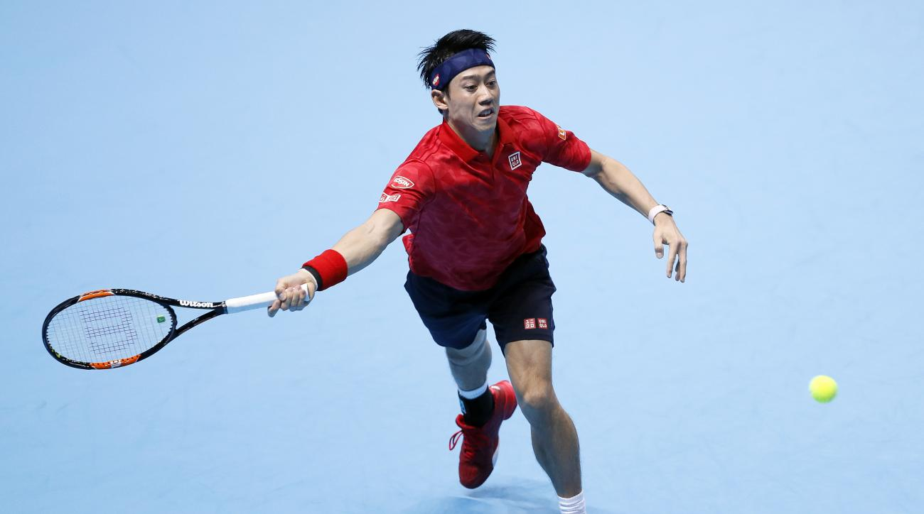 Kei Nishikori of Japan plays a return to Stan Wawrinka of Switzerland during their ATP World Tour Finals singles tennis match at the O2 Arena in London, Monday, Nov. 14, 2016. (AP Photo/Kirsty Wigglesworth)
