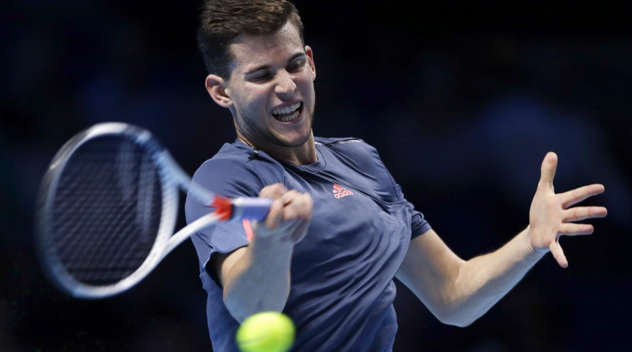 Austria's Dominic Thiem plays a return to France's Gael Monfils during their ATP World Tour Finals singles tennis match at the O2 arena in London, Tuesday, Nov. 15, 2016. (AP Photo/Alastair Grant)