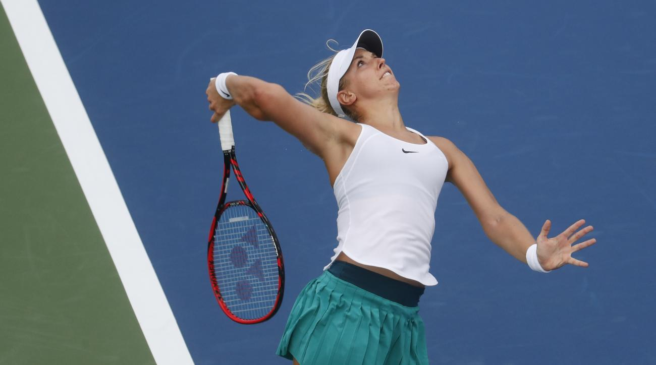 Sabine Lisicki, of Germany, serves to Zheng Saisai, of China, during the qualifying rounds at the Western & Southern Open tennis tournament, Sunday, Aug. 14, 2016, in Mason, Ohio. (AP Photo/John Minchillo)