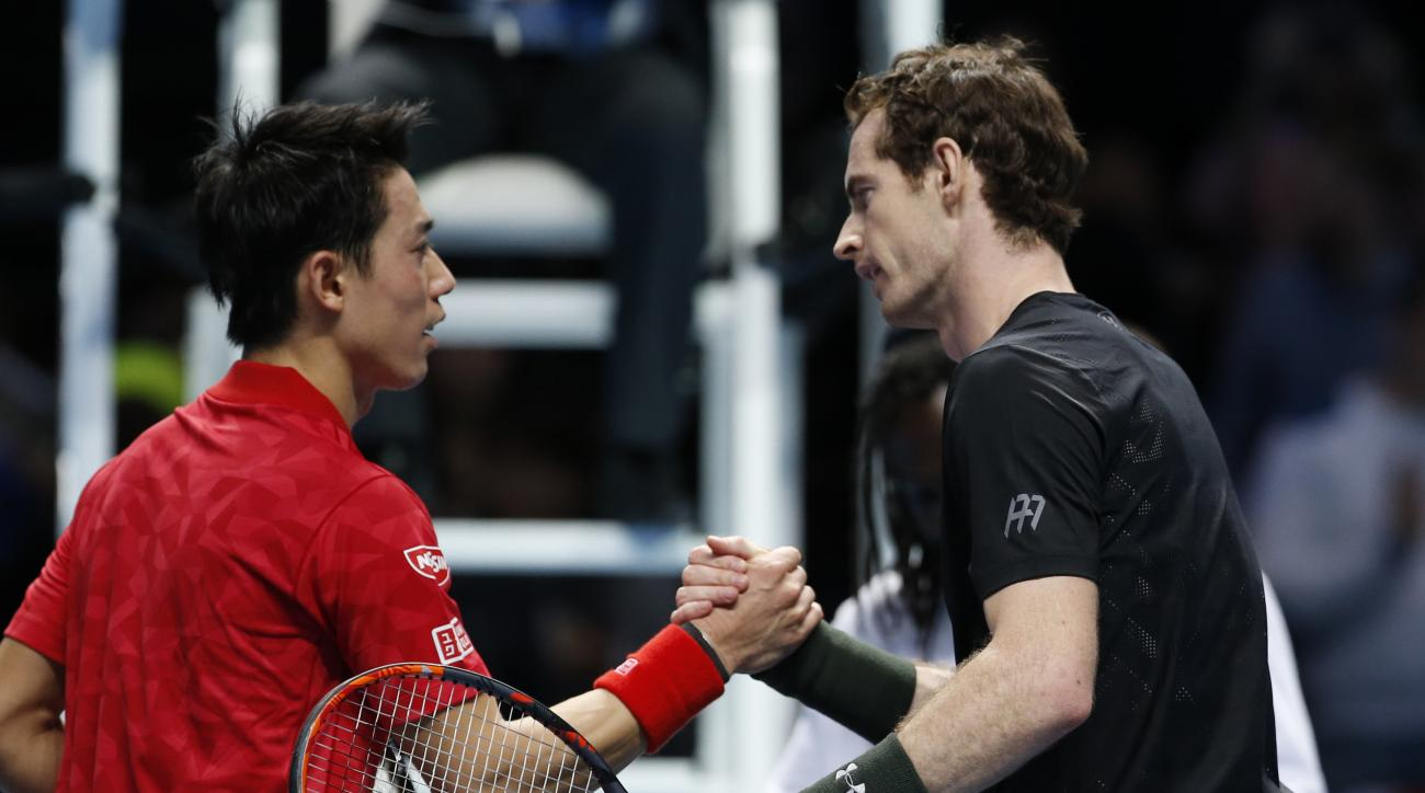 Britain's Andy Murray, right, shakes hands with Kei Nishikori of Japan after winning the ATP World Tour Finals singles tennis match at the O2 arena in London, Wednesday, Nov. 16, 2016. (AP Photo/Alastair Grant)