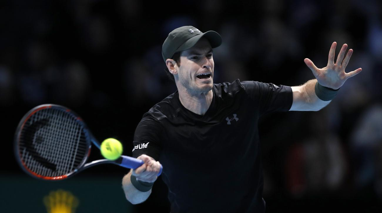 Andy Murray of Britain plays a return to Milos Raonic of Canada during their ATP World Tour Finals semifinal singles tennis match at the O2 Arena in London, Saturday, Nov. 19, 2016. (AP Photo/Kirsty Wigglesworth)
