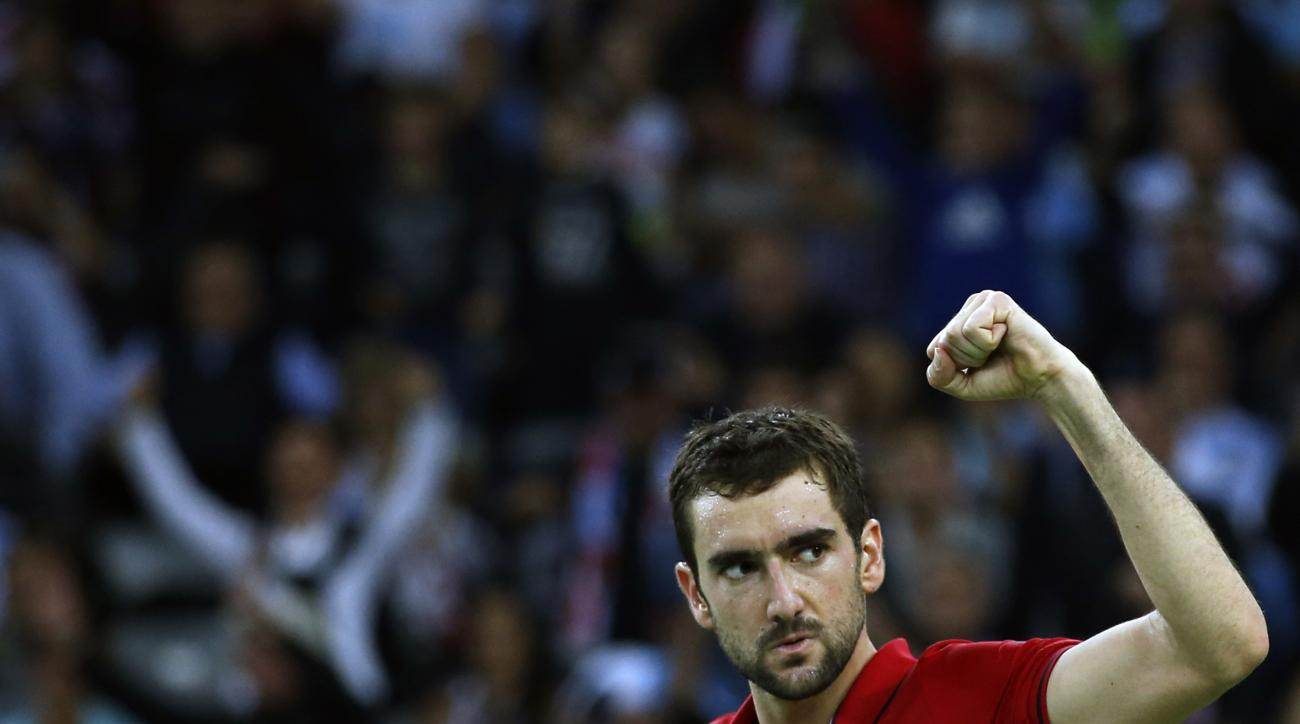 Croatia's Marin Cilic celebrates after winning his singles match against Argentina's Federico Delbonis in the Davis Cup tennis tournament final between the two countries in Zagreb, Croatia, Friday, Nov. 25, 2016.(AP Photo/Darko Vojinovic)