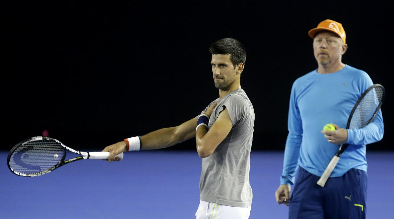 FILE - In this Jan. 14, 2016, file photo, Serbia's Novak Djokovic, right, walks with his coach Boris Becker during a training session on Rod Laver Arena ahead of the Australian Open tennis championships in Melbourne, Australia. Djokovic says he and coach