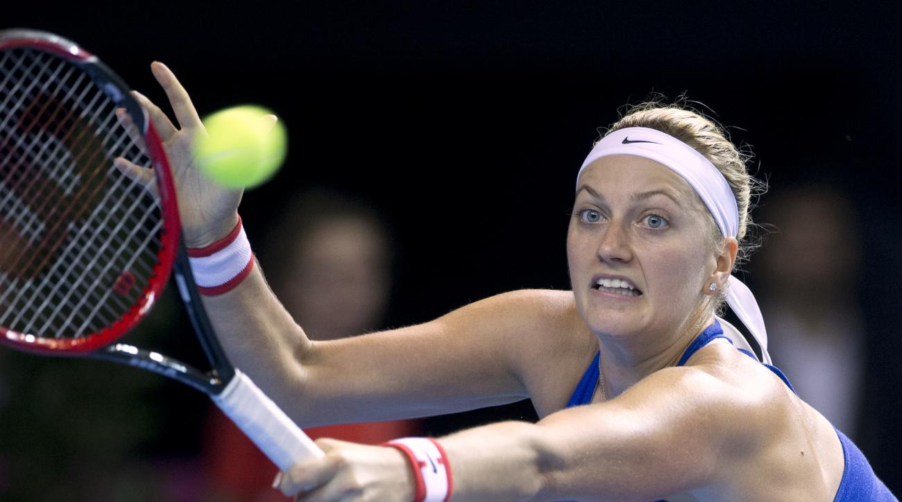 FILE - In this Nov. 12, 2016 file picture Czech Republic's Petra Kvitova returns the ball to France's Caroline Garcia during the Fed Cup final in Strasbourg, eastern France. Two-time Wimbledon champion Petra Kvitova has been injured during an attack in he
