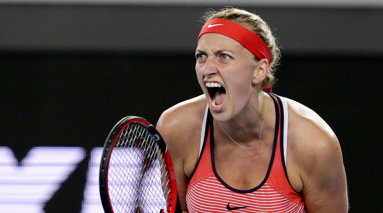 FILE - This is a Wednesday, Jan. 20, 2016 file photo of Petra Kvitova of the Czech Republic, clenches her left hand as she reacts after winning a point against Daria Gavrilova of Australia during their second round match at the Australian Open tennis cham