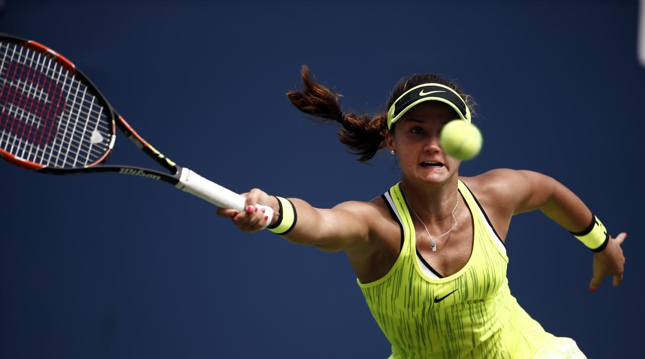 Lauren Davis, of the United States, returns a shot to Elina Svitolina, of Ukraine, during the second round of the U.S. Open tennis tournament, Wednesday, Aug. 31, 2016, in New York. (AP Photo/Andres Kudacki)