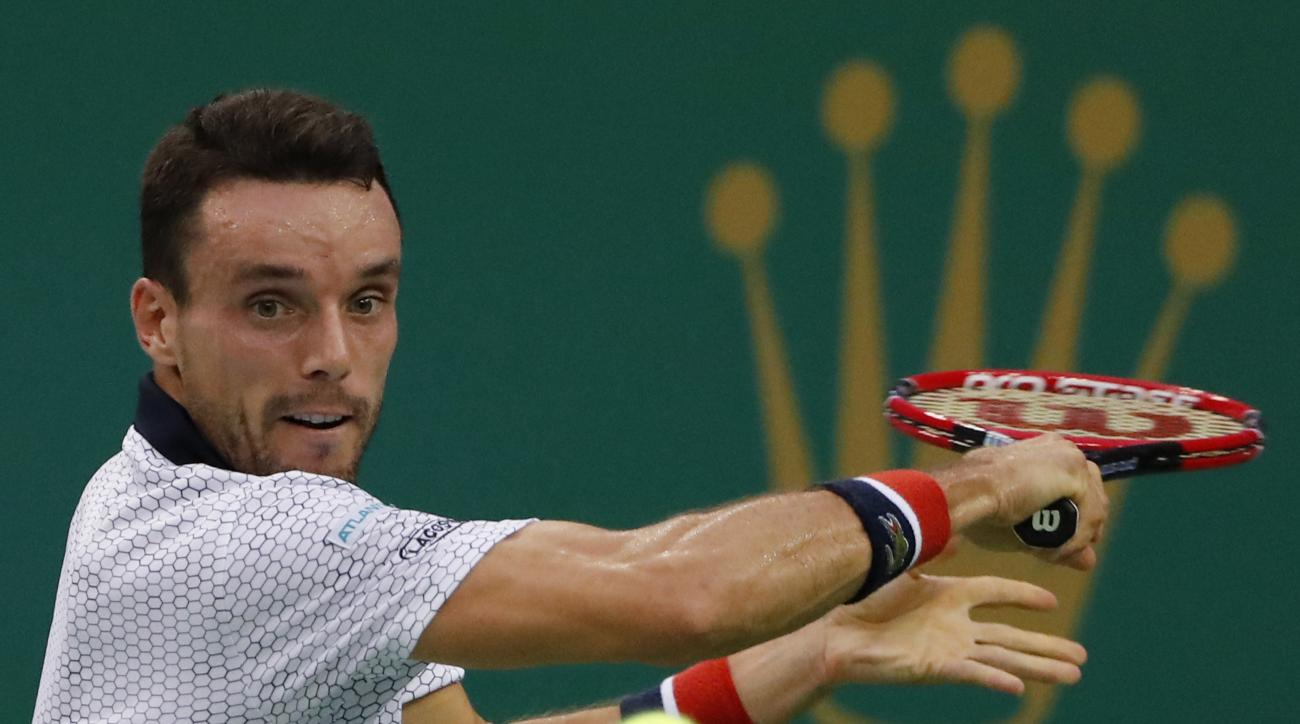 Roberto Bautista Agut of Spain hits a return shot against Andy Murray of Britain during the men's singles final of the Shanghai Masters tennis tournament at Qizhong Forest Sports City Tennis Center in Shanghai, China, Sunday, Oct. 16, 2016. (AP Photo/Andy