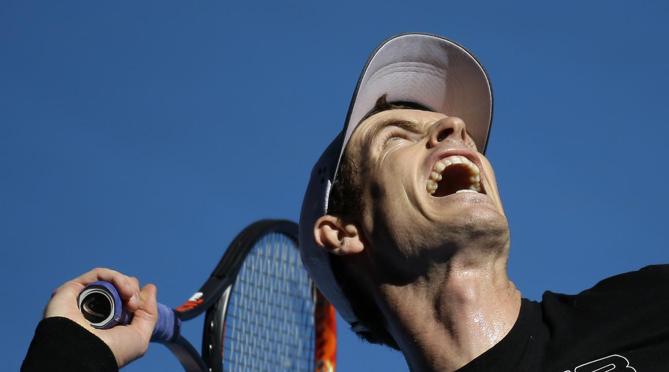 Britain's Andy Murray serves during a practice session ahead of the Australian Open tennis championships in Melbourne, Australia, Thursday, Jan. 12, 2017. (AP Photo/Mark Baker)
