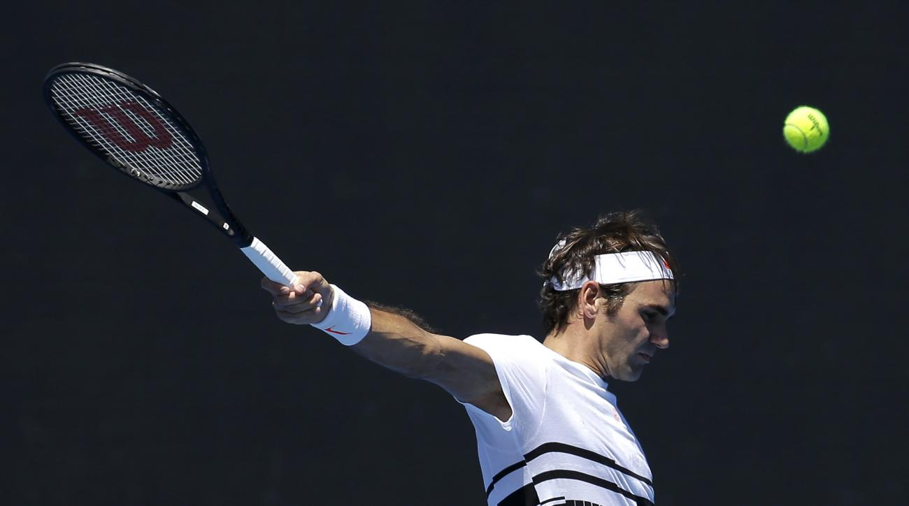 Switzerland's Roger Federer plays a backhand return during a practice session ahead of the Australian Open tennis championships in Melbourne, Australia, Thursday, Jan. 12, 2017. (AP Photo/Mark Baker)