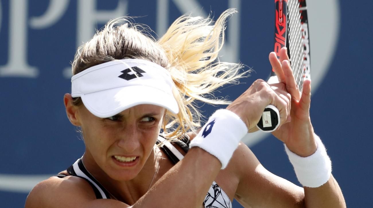 Lesia Tsurenko, of Ukraine, returns a shot to Dominika Cibulkova, of Slovakia, during the third round of the U.S. Open tennis tournament, Friday, Sept. 2, 2016, in New York. (AP Photo/Alex Brandon)