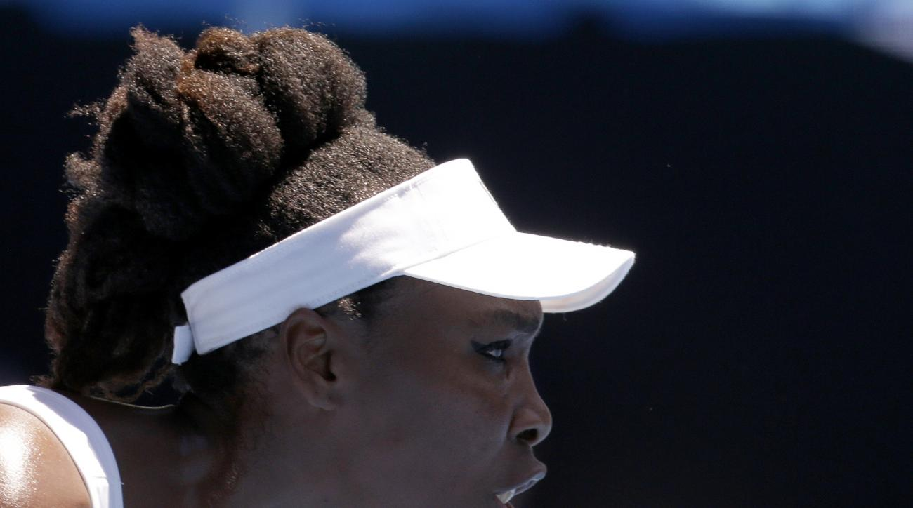 United States' Venus Williams focuses on Ukraine's Kateryna Kozlova during their first round match at the Australian Open tennis championships in Melbourne, Australia, Monday, Jan. 16, 2017. (AP Photo/Aaron Favila)