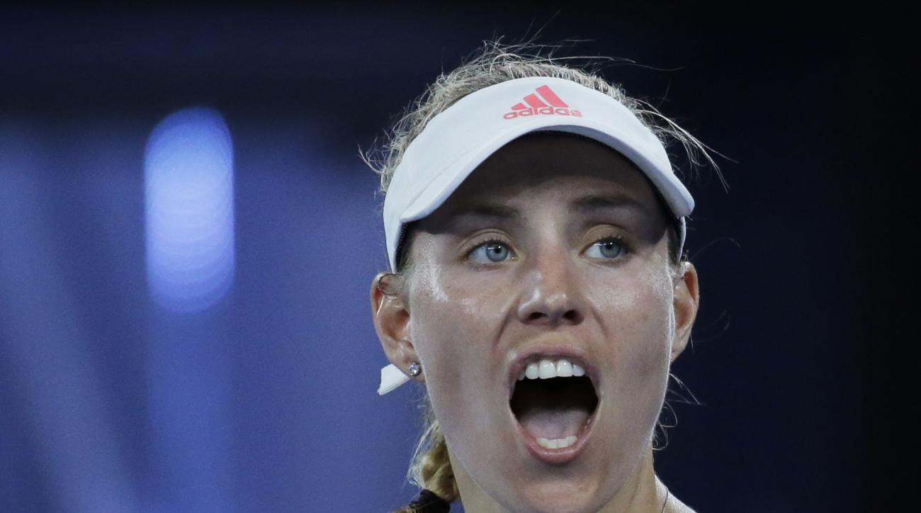 Germany's Angelique Kerber celebrates after defeating Ukraine's Lesia Tsurenko during their first round match at the Australian Open tennis championships in Melbourne, Australia, Monday, Jan. 16, 2017. (AP Photo/Aaron Favila)