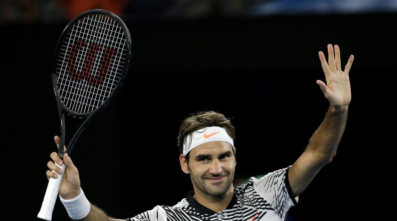 Switzerland's Roger Federer celebrates after defeating Austria's Jurgen Melzer in their first round match at the Australian Open tennis championships in Melbourne, Australia, Monday, Jan. 16, 2017. (AP Photo/Aaron Favila)