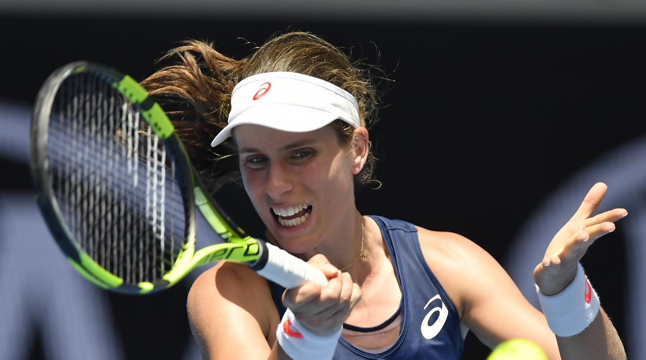 Britain's Johanna Konta makes a forehand return to Belgium's Kirsten Flipkens during their first round match at the Australian Open tennis championships in Melbourne, Australia, Tuesday, Jan. 17, 2017. (AP Photo/Andy Brownbill)