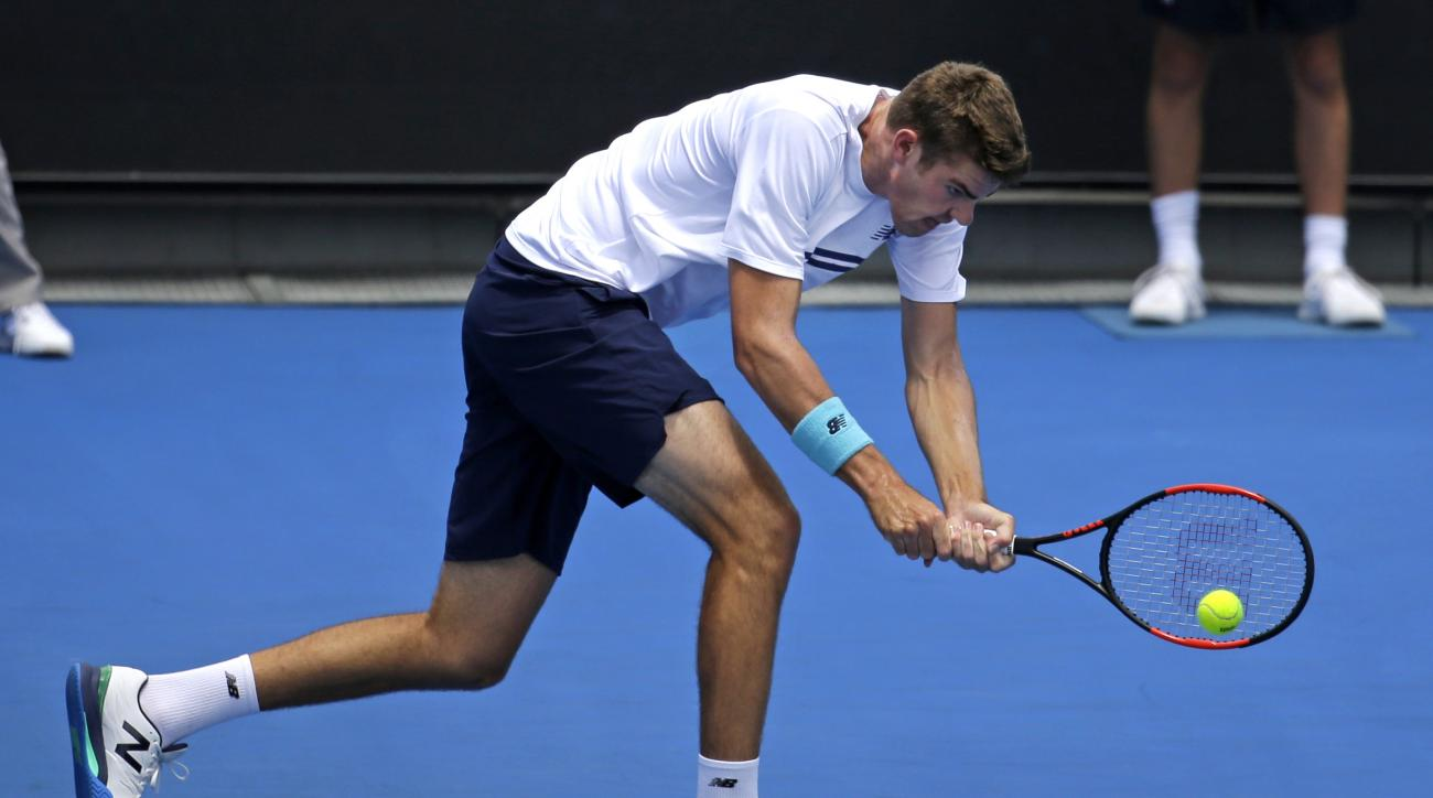United States' Reilly Opelka makes a backhand return to Belgium's David Goffin during their first round match at the Australian Open tennis championships in Melbourne, Australia, Tuesday, Jan. 17, 2017. (AP Photo/Aaron Favila)